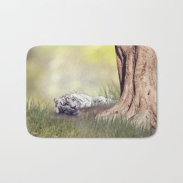 White tiger resting under a big tree Bath Mat