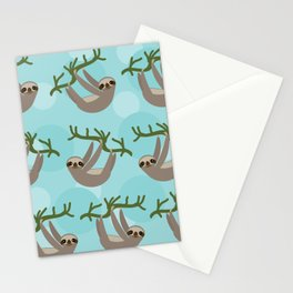 Three-toed sloth on green branch blue background Stationery Cards