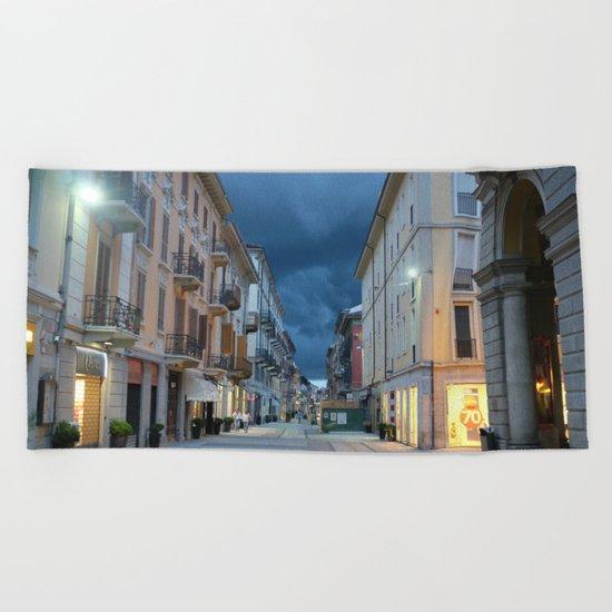 A stormy night in Alessandria, Italy Beach Towel