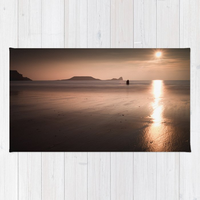 Sunset and wet sand at Worms Head, Gower, Wales Rug