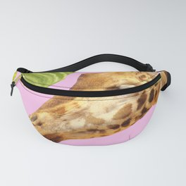 Giraffe with green leaves on a pink background Fanny Pack
