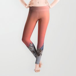 Glowing sunset sky and snowy mountains Leggings