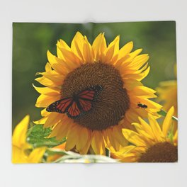The butterfly the bee and the sunflower Throw Blanket