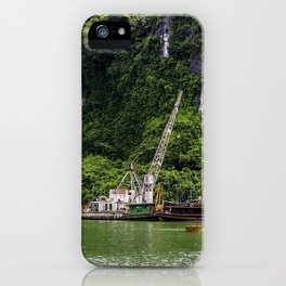 Colorful Houseboats Parked at the Base of a Limestone Mountain Covered in Green Trees and Bushes in Halong Bay, Vietnam iPhone Case