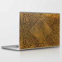 book cover Laptop & iPad Skins featuring Vintage Ornamental Book Cover by Nicolas Raymond