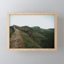 Hiking along Hadrian's wall in the vast landscape of England Framed Mini Art Print