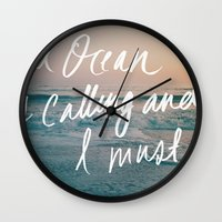 leah flores Wall Clocks featuring The Ocean is Calling by Laura Ruth and Leah Flores  by Laura Ruth