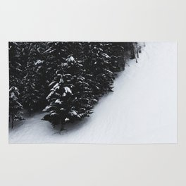 Black and white spruce forest and snow Rug