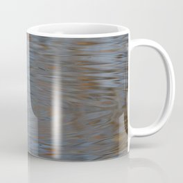 Great crested grebe swims in the calm waters Coffee Mug