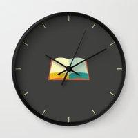 katniss Wall Clocks featuring Katniss by Ariel Wilson