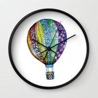 hot air balloon Wall Clocks featuring Hot Air Balloon by Emily Stalley