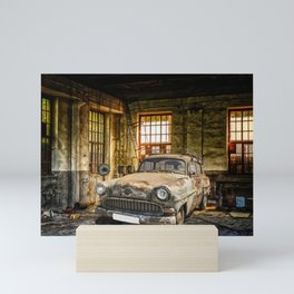 Old Car in a Garage Mini Art Print