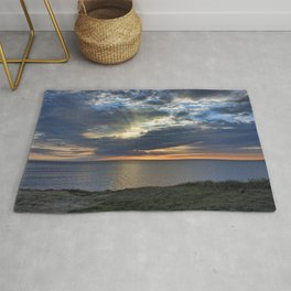 Sunsetting on Widemouth Bay Rug