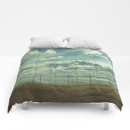 Empty beach Comforters