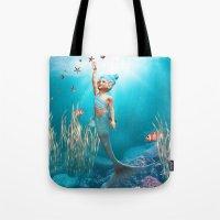 little mermaid Tote Bags featuring Little Mermaid by Simone Gatterwe