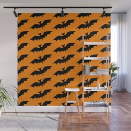 Black bats on an orange background in the style of Halloween Wall Mural