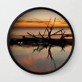 Driftwood on the beach at sunrise Wall Clock
