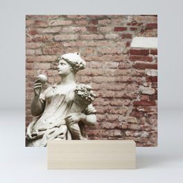 Old Brick Wall and Statue of a Woman Mini Art Print