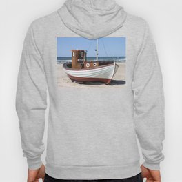 Wooden fishing boat on the beach. Hoody