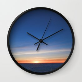 Blue sky in  sunset light on the horizon over  the glittering  icy snowy white Baltic sea desert Wall Clock