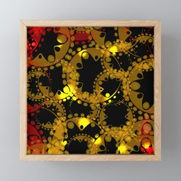 abstract glowing pattern of gears and spheres in red gold on a black background for fabrics o Framed Mini Art Print