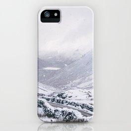 Heavy snow falling over the Kirkstone Pass. Cumbria, UK. iPhone Case