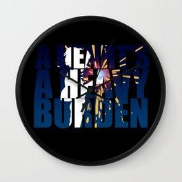 A heart is a heavy burden Wall Clock