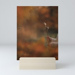 Dried seeds pods of poppies in autumn bokeh Mini Art Print