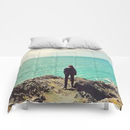 Girl looking out to sea Comforters