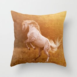 Andalusian stallion playing at sunset Throw Pillow