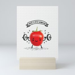 Cute tomato lifts heavy weight using barbell. Funny bodybuilder illustration. Healthy lifestyle... Mini Art Print