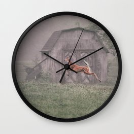 Leaping deer in front of barn with foggy background Wall Clock