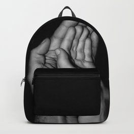 Father and child / Photograph of father and child hands pressed together Backpack