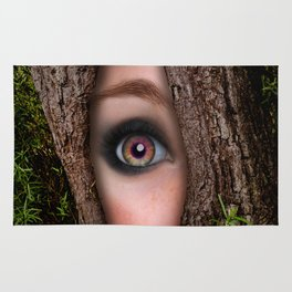 Beautiful Face trapped in a tree trunk Rug
