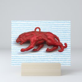 Red panther on blue grass Mini Art Print