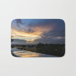 Reflective Sunset Bath Mat