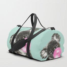 Playful Koala Bear with Bubble Gum in Green Duffle Bag