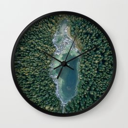 Aerial photo of a magic lake hidden inside a pine forest Wall Clock