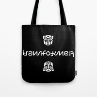 transformer Tote Bags featuring TRANSFORMER ambigram by Reverse