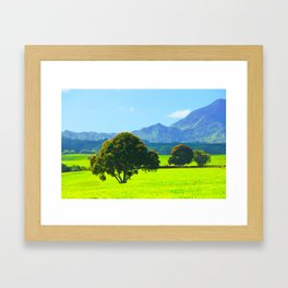 green tree in the green field with green mountain and blue sky background Framed Art Print