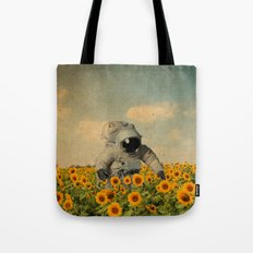 astronaut in a sunflower's field Tote Bag
