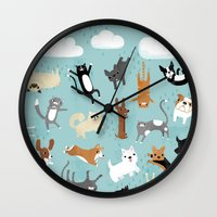 dogs Wall Clocks featuring Raining Cats & Dogs by Anne Was Here