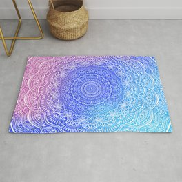 Beautiful colorful rainbow mandala Sophisticated ornament pink and violet cyan Rug