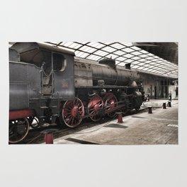 steam locomotive inside the train station Rug