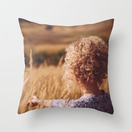Girl in the field Throw Pillow
