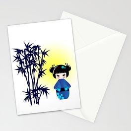 Japanese kokeshi doll at bamboo at sunrise Stationery Cards