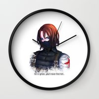 the winter soldier Wall Clocks featuring The Winter Soldier by TEAM JUSTICE ink.