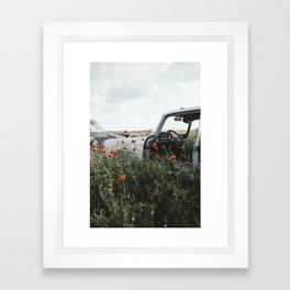 Old car in poppy field Framed Art Print