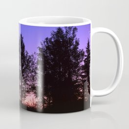 Nightfall. Purple and pink sky in the forest after sunset. Coffee Mug