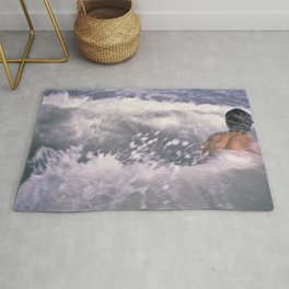 Brian swimming in the sea Rug